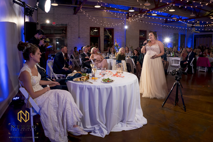 the maid of honor giving her toast to the bride and groom in Market Hall