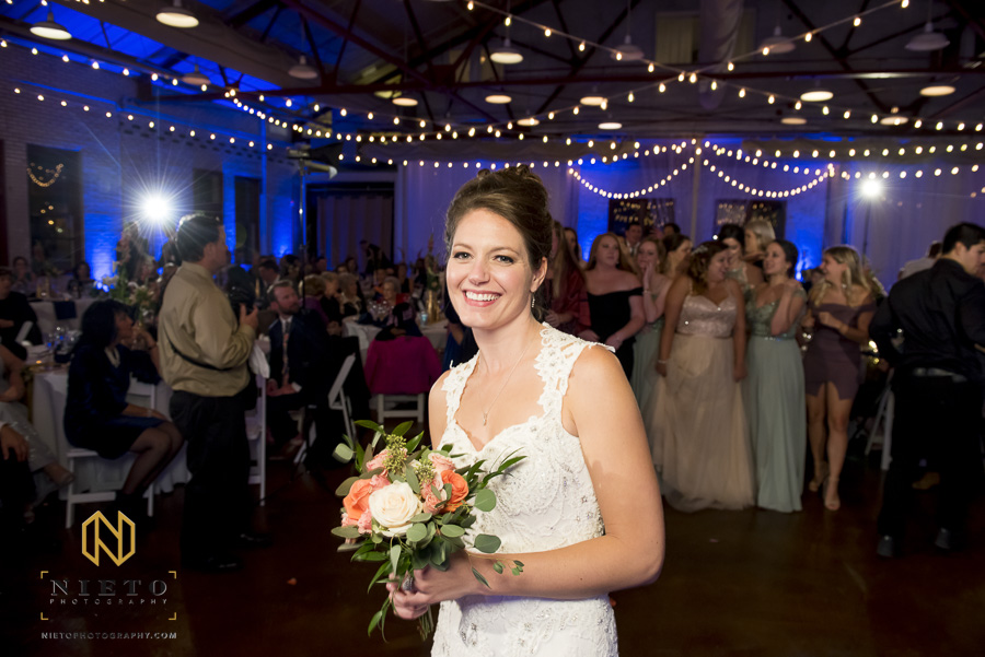 the bride smiling before she throws her bouquet to the single ladies at Market Hall