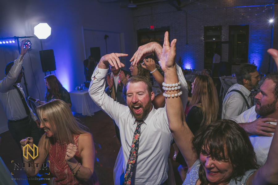 wedding guest dancing to YMCA at Market Hall