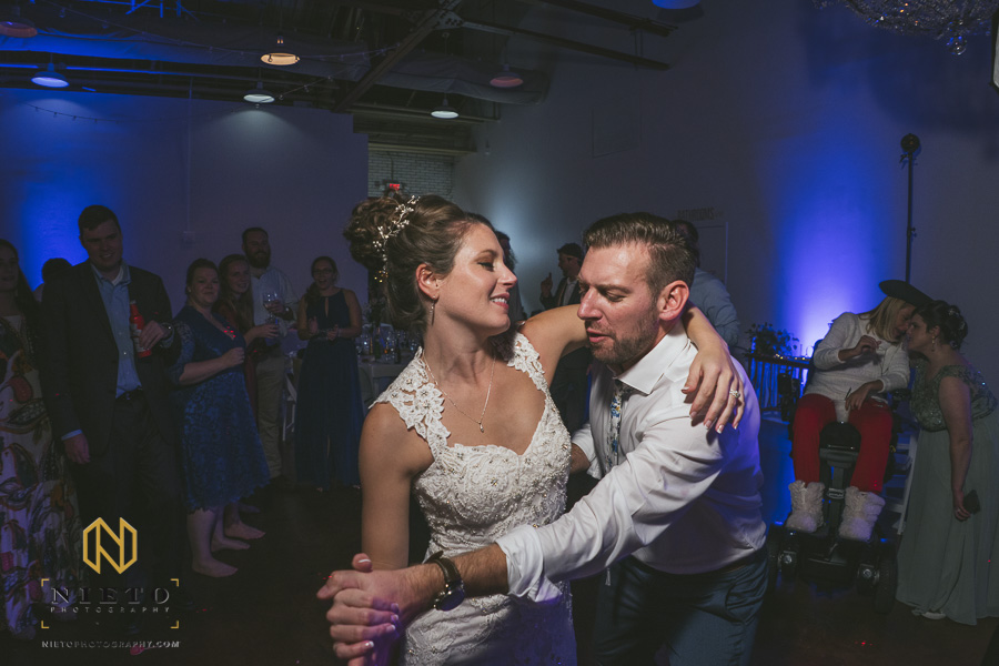 bride dancing with her arms around the groom at Market Hall