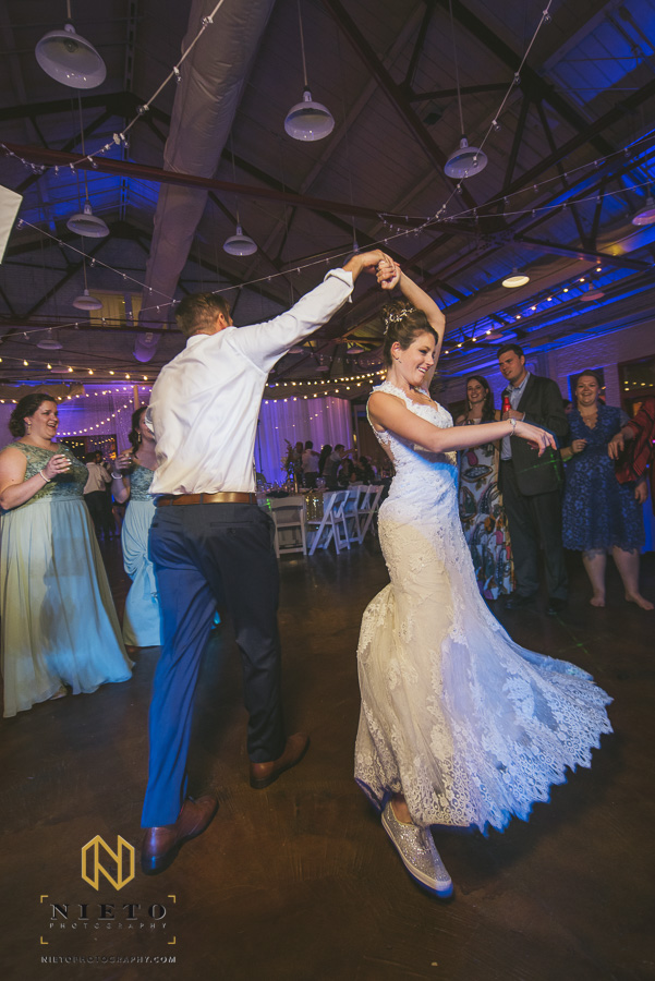 wedding guest twirling the bride on the dance floor at Market Hall