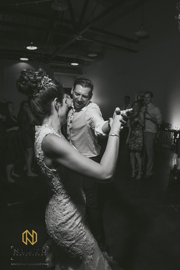 black and white picture of the bride and groom dancing together