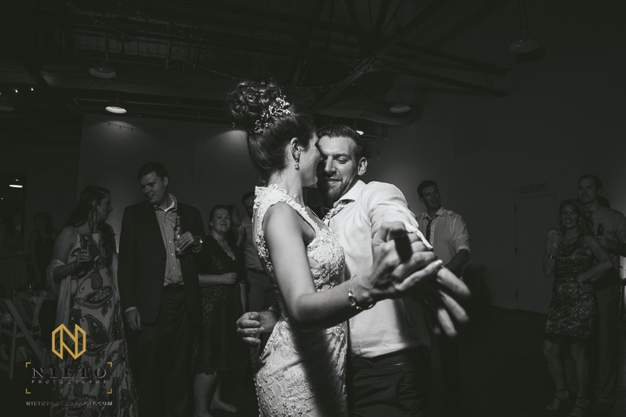 black and white image of bride and groom dancing during their Market Hall wedding reception