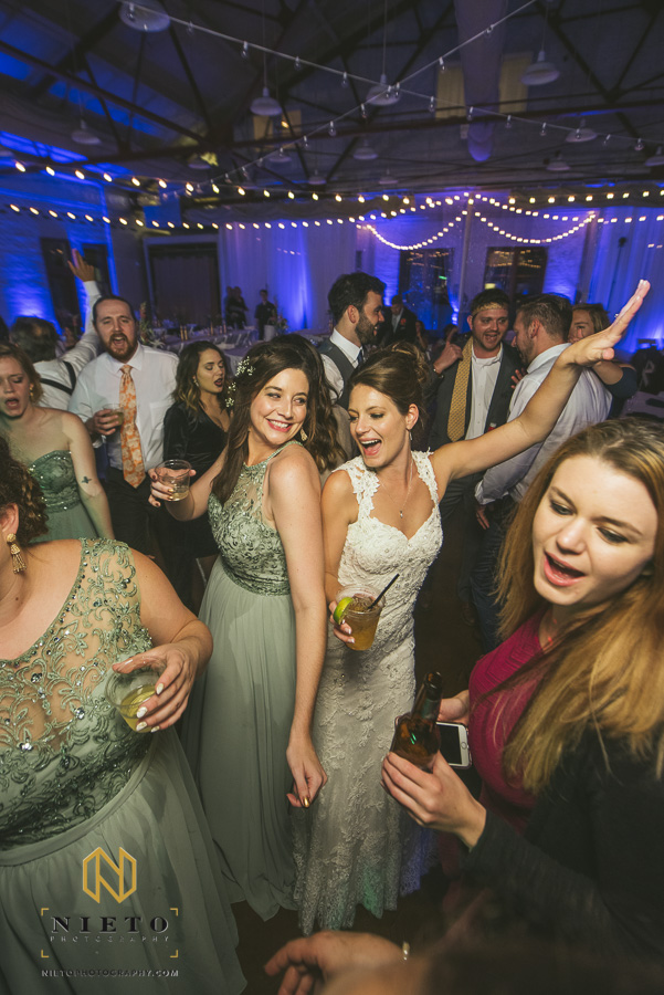 bridesmaid smiling as she dances with the bride at Market Hall