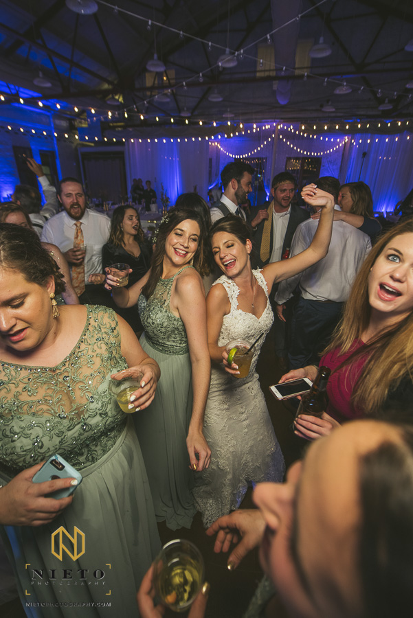 bride and bridesmaid dancing together back to back at Market Hall