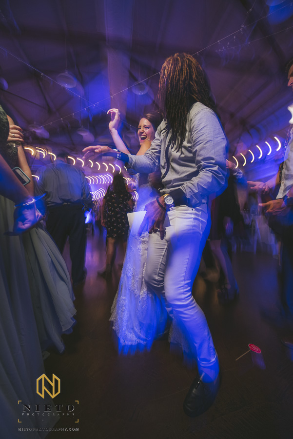 bride dancing with a wedding guest at Market Hall