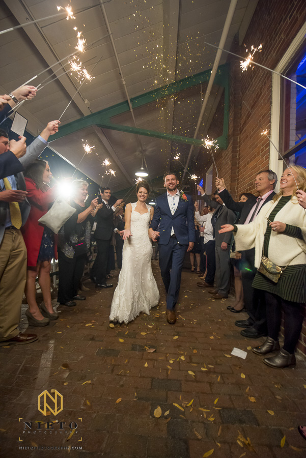 Market Hall wedding exit with bride and groom showered in gold glitter