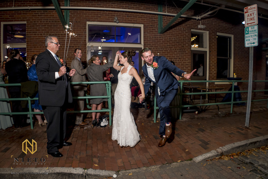 the groom dancing outside of market hall after his sparkler exit