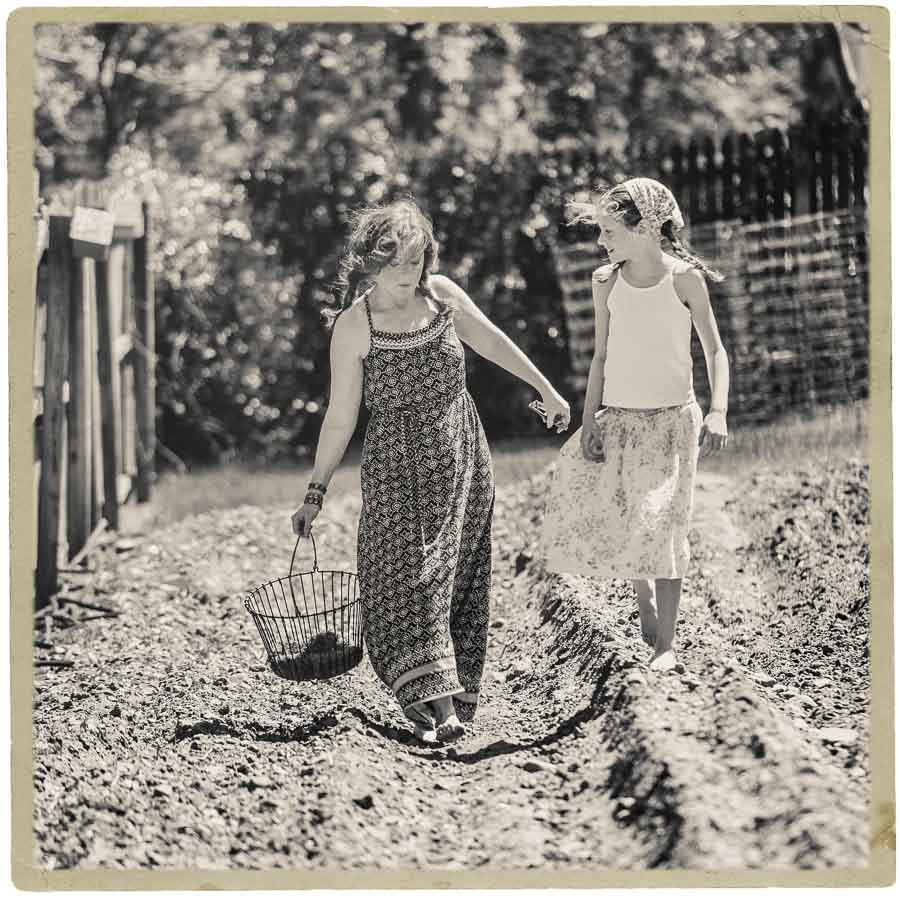 framed black and white image of a mother and daughter on an Apex NC farm
