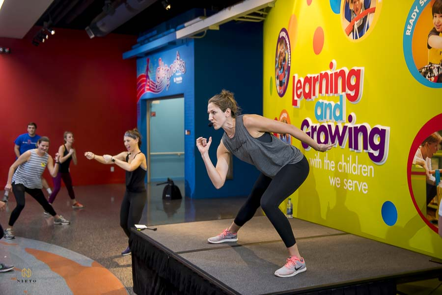 Ashely and Brittany leading the Raleigh Group Fitness Winter Workout warm up at Marbles Kids Museum.