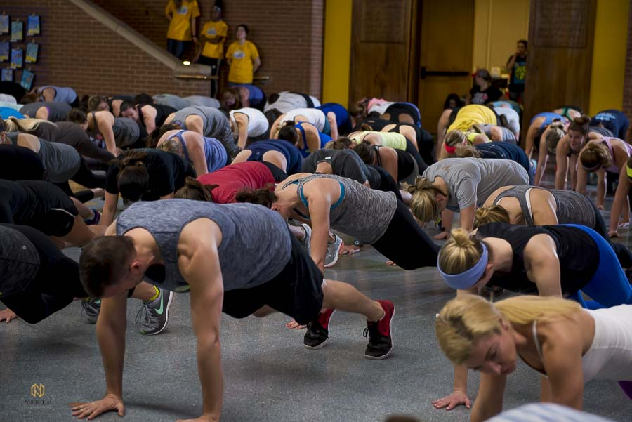 workout guest doing pushups together during the Raleigh Group Fitness event