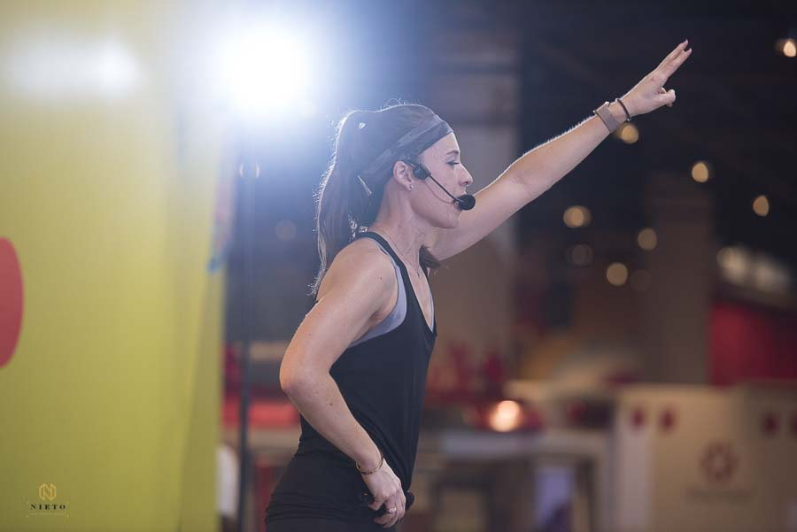 Ashley Liu Kirkman of raleigh group fitness counting down during one of the work out circuits