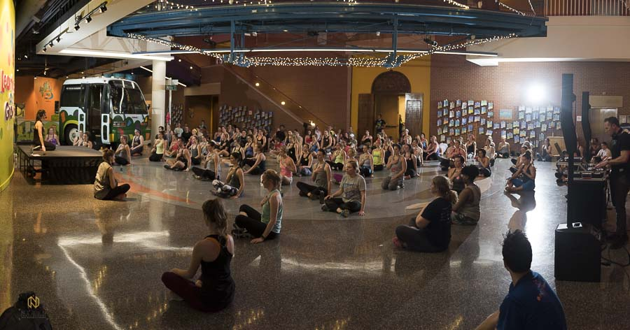 wide shot of the main room during the cool down session of Raleigh Group Fitnesses winter workout