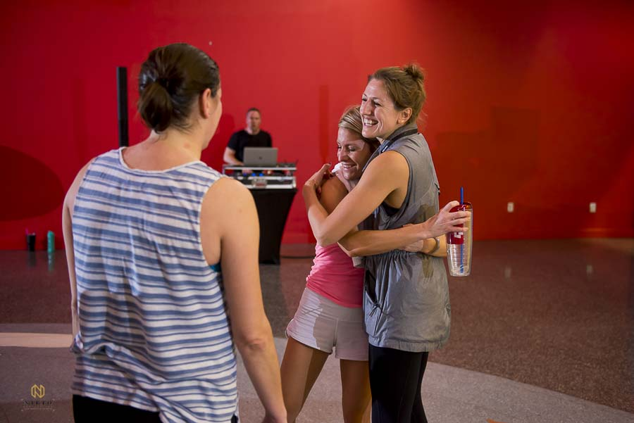 Brittany Guerin of Raleigh Group Fitness hugging one of the workout guest