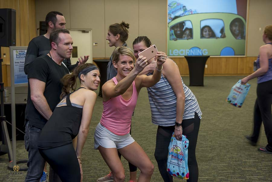 raleigh group fitness guest taking a selfie with Joe Bunn and ashley after the workout