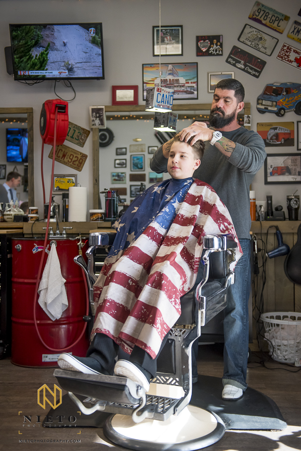 the grooms son having his hair styled at Van-tique-barbershop