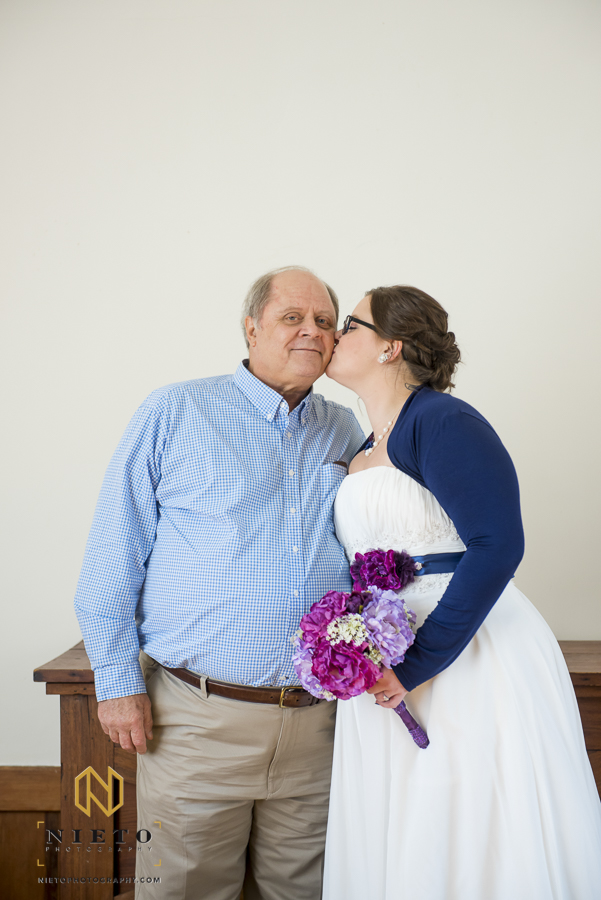 father of the bride getting a kiss from his daughter