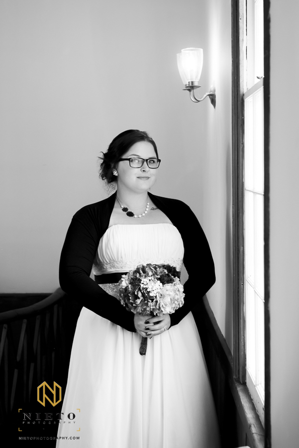black and white picture of the bride standing near a window inside St. Mark's Chapel