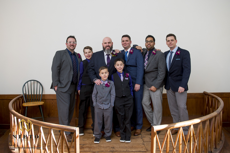groom posing with his sons and his groomsmen inside of St Mark's Chapel