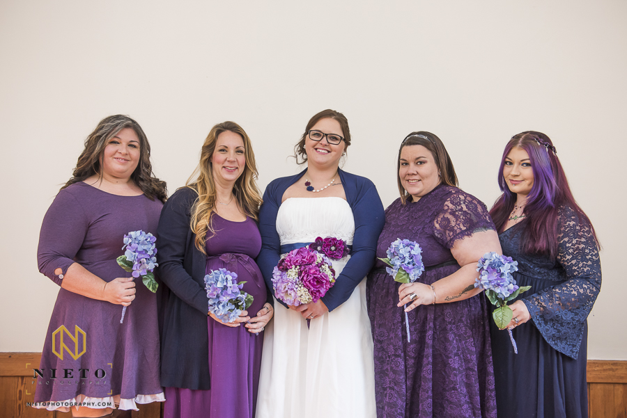 the bride and her bridesmaids posing for a formal portrait