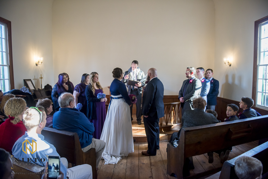 small intimate wedding taking place inside of St. Mark's Chapel