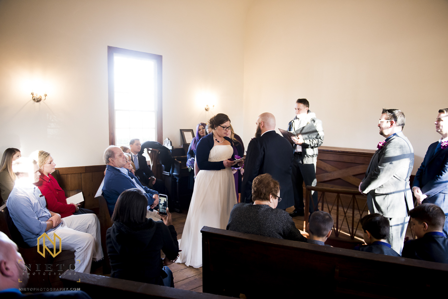 The bride reading her vows to the groom inside of St. Mark's Chapel during their Mordecai Historic Park wedding
