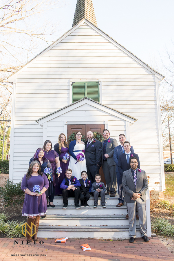 bridal party portrait in front of St. Mark's Chapel in Mordecai Historic Park