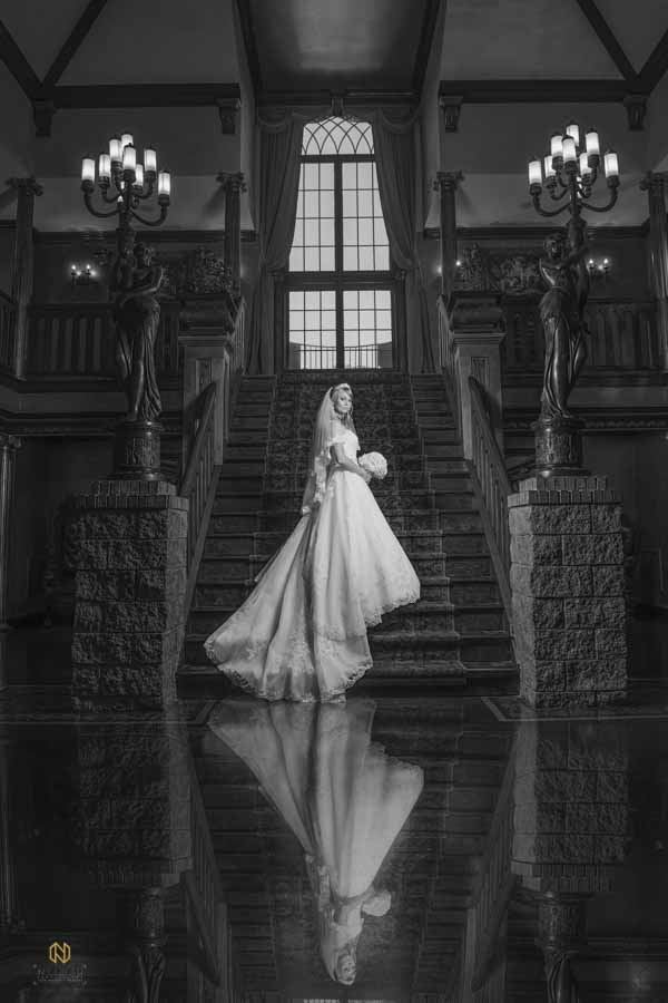 black and white Barclay Villa Bridal Portrait of a bride posing on the stairs with her reflection in the floor