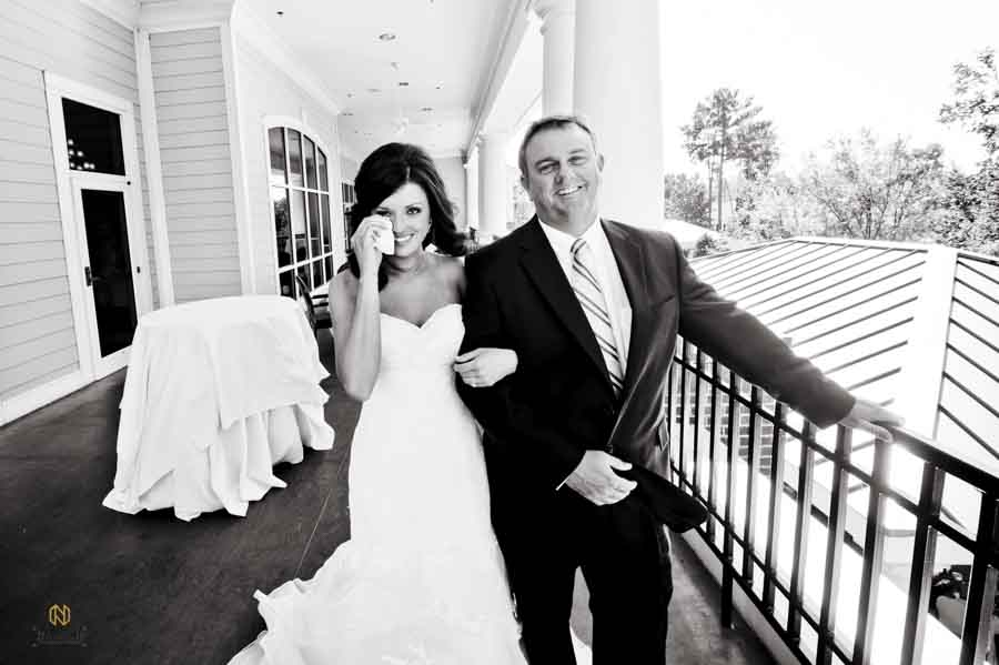 Bride crying when seeing her father for the first time before the ceremony starts at Brier Creek Country Club