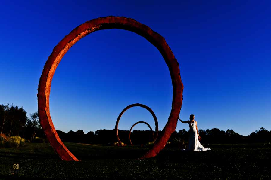Bride posing against one of the Rings at the NC Museum of Art