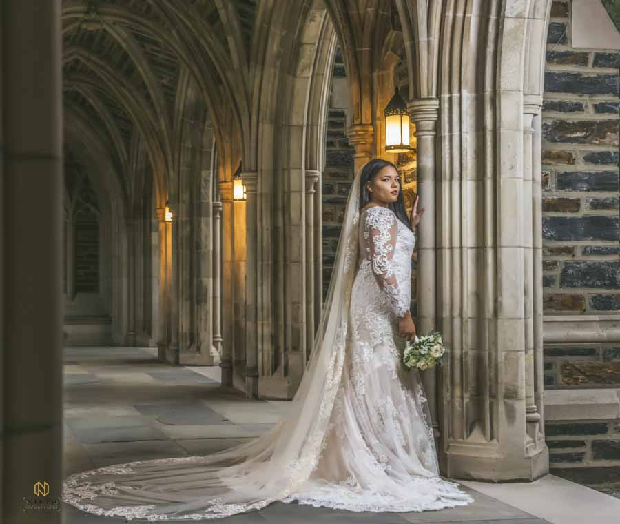 Bride posing in hallway of Duke Chapel for portrait