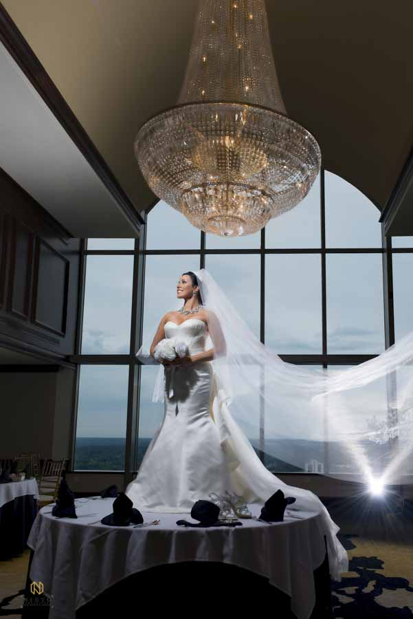 Bride standing on a table at City Club Raleigh in downtown raleigh