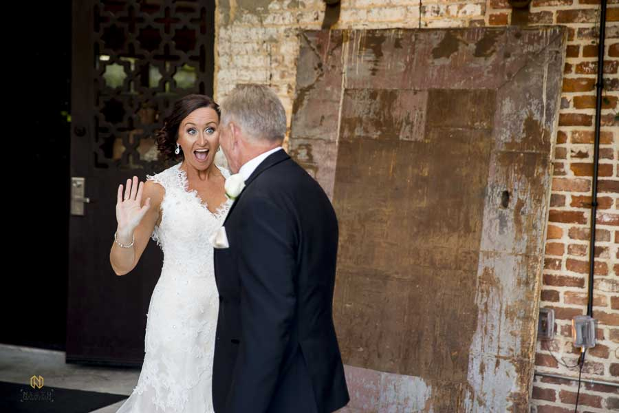 Bride being very excited as her father sees her as they see each other at their first look