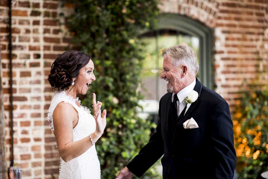 bride and her father being very excited to see each other for the first time at Melrose Knitting Mill