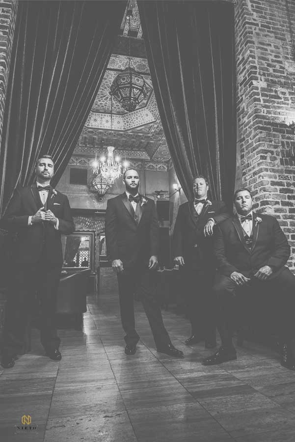 black and white formal portrait of the groomsmen and the groom at Melrose Knitting Mill