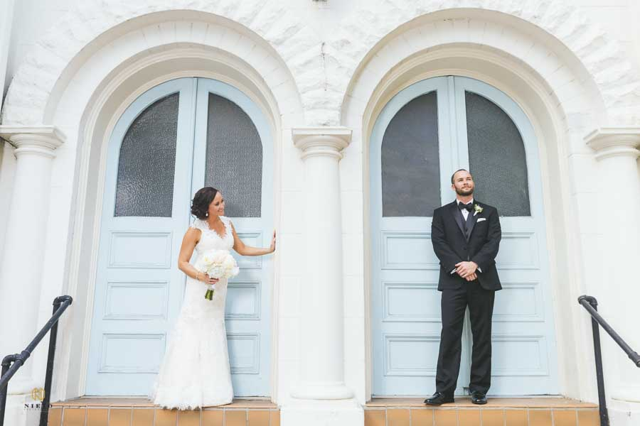 the bride and groom standing in separate door ways at the Vintage Church in Raleigh