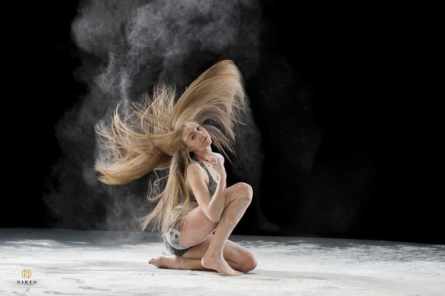 dancer with flour all over her face flipping her hair