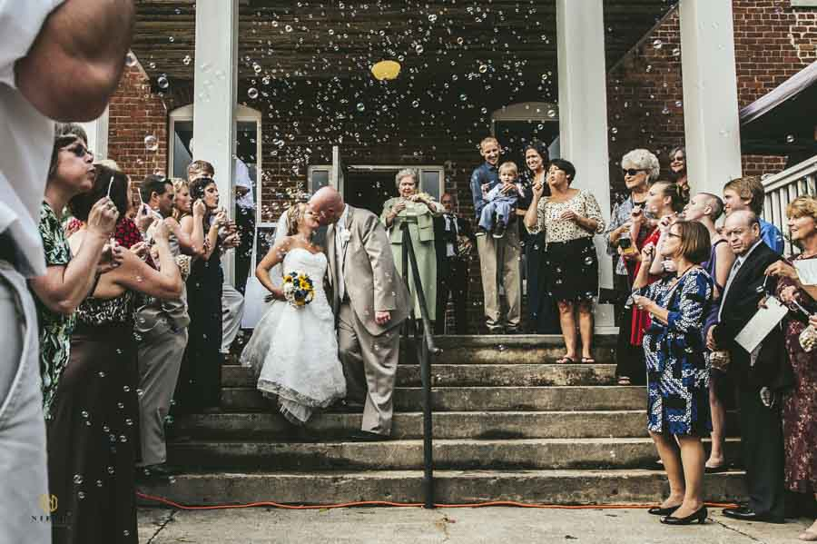 bride and groom kissing during their bubble exit in Roanoke Rapids