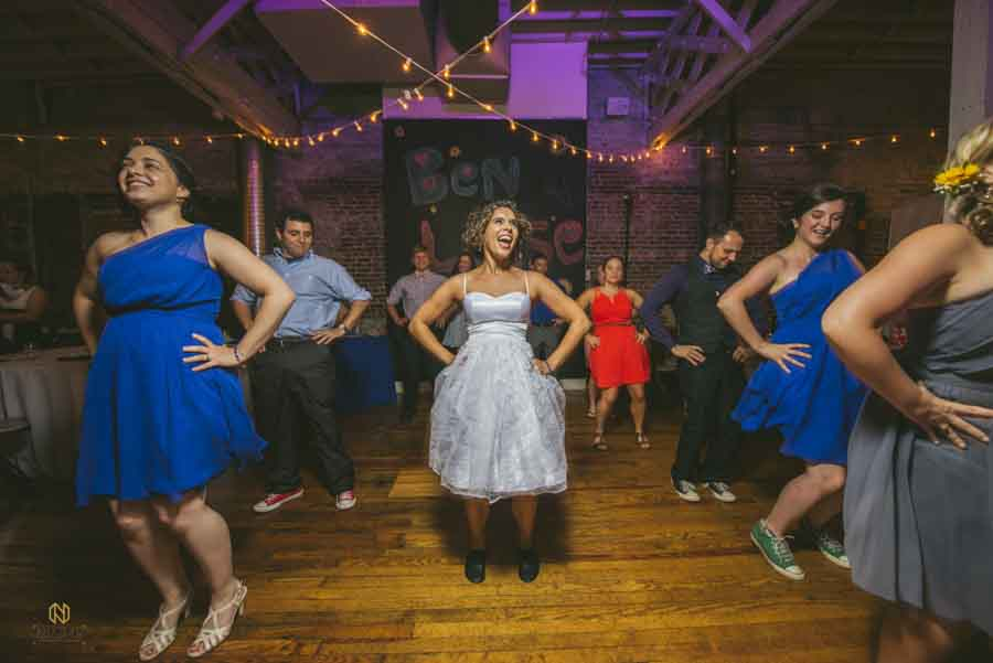 Bride dancing to the time warp during her wedding reception at the stockroom