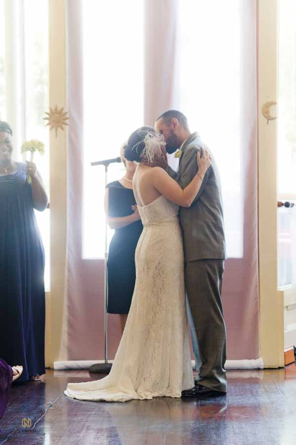 Caffe Luna wedding ceremony with the bride and groom kissing