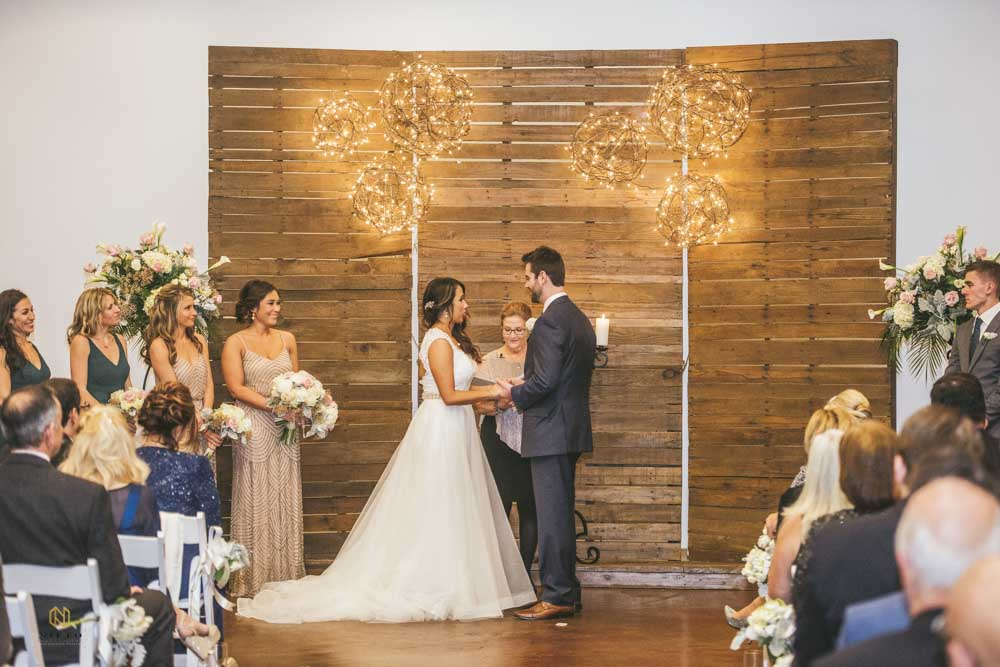 Market Hall wedding ceremony with the bride and groom holding hands