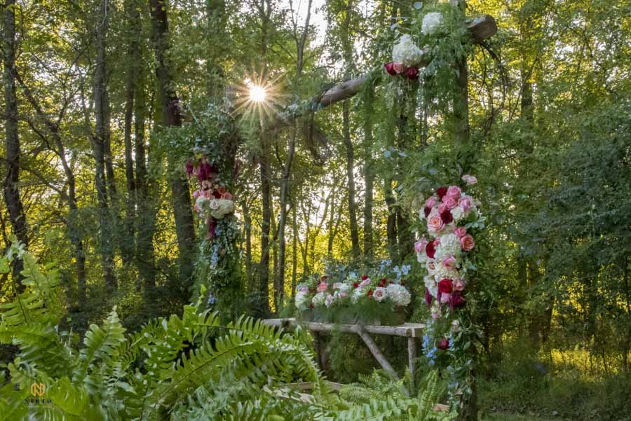 decorated altar at cedar grove acres with florals from southern petals