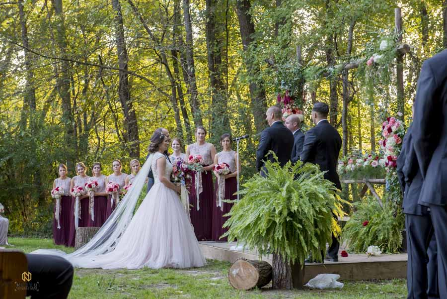 bride standing at the alter during her Cedar Grove Acres wedding ceremony