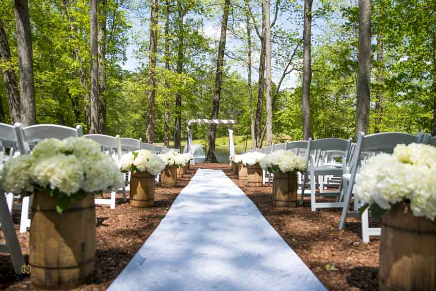 a white runner going down the aisle at chapel in the woods