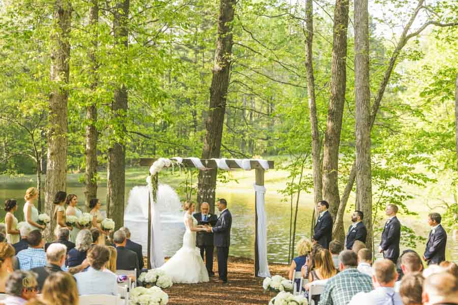 bride and groom holding hands during their chapel in the woods ceremony