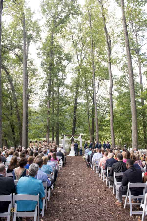 Chapel in the Woods outdoor ceremony with guest watching the bride and groom