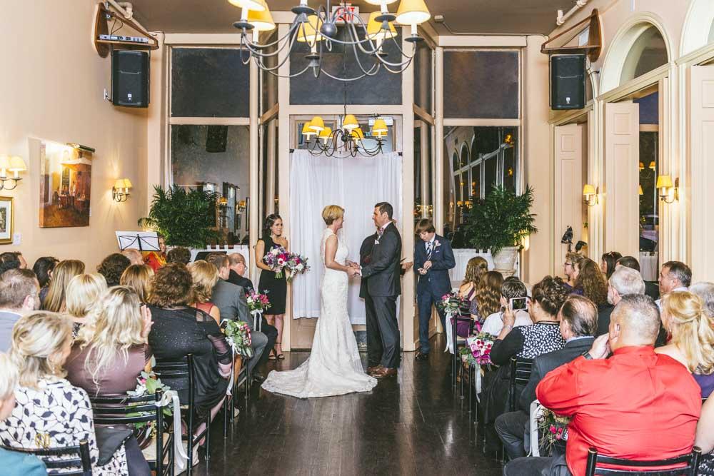 bride and groom holding hands at a Caffe Luna wedding ceremony
