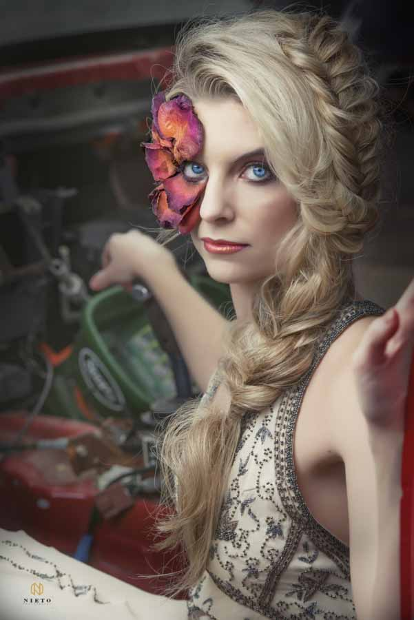 Editorial Bridal Portraits of model siting in a car with flowers around her eye