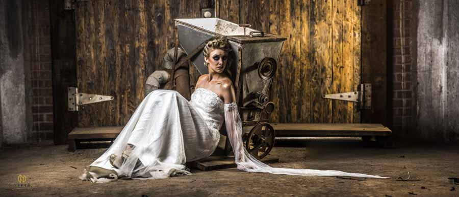an Editorial Bridal Portrait shot in front of an old piece of machinery