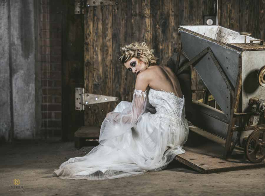 Editorial Bridal Portraits with the bride looking over her shoulder in an old textile factory